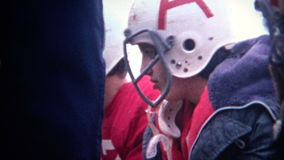 (8mm Vintage) Sad Football Players on The Bench stock footage