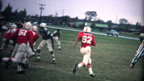 (8mm Vintage) Youth Football Action stock footage