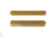 8 and 6 mm Wooden pegs. On white background Royalty Free Stock Photos