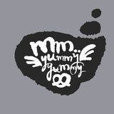 Mm Yummy Yummy in a Speech Bubble. Mm Yummy Yummy. Hand written calligraphy phrase in a speech bubble. White on black. Clipping paths included Royalty Free Stock Photos