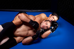MMA. Mixed martial artists fighting - ground fighting stock image