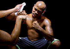 MMA Fighter or Boxer with Trainer Applying Athletic Tape Stock Image