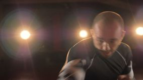 A close-up on a fighter punching air and avoiding hits. A MMA fighter in close-up shows how to punch and evade hits stock footage