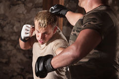 MMA Fighter Dodges a Punch Royalty Free Stock Image