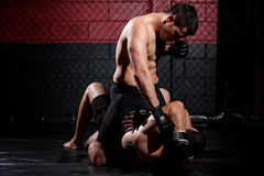 MMA fighter dominating the match Royalty Free Stock Photo