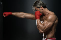 MMA Fighter Practicing With Boxing Bag Stock Images