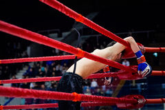 MMA fighter on ropes of the ring stock photography