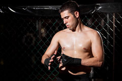 MMA Fighter wrapping his hands Royalty Free Stock Images