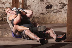 MMA Fighters in Choke Hold Training. Two men training in rear choke holds Royalty Free Stock Photos