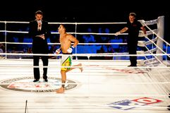 MMA fights without rules. Agoni Romero, Spain and Rinat Kul?tumanov, Russia Royalty Free Stock Photos
