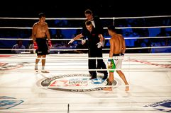 MMA fights without rules. Agoni Romero, Spain and Rinat Kul?tumanov, Russia Royalty Free Stock Photo