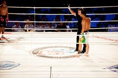 MMA fights without rules. Agoni Romero, Spain and Rinat Kul?tumanov, Russia Stock Photo