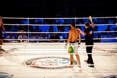 MMA fights without rules. Agoni Romero, Spain and Rinat Kul?tumanov, Russia. Mixed fighting Championship Edition. 29.06.2013 year, the city of Orenburg. MMA Stock Image