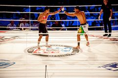 MMA fights without rules. Agoni Romero, Spain and Rinat Kul?tumanov, Russia Stock Photography