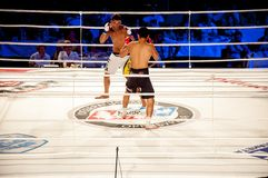 MMA fights without rules. Agoni Romero, Spain and Rinat Kul?tumanov, Russia. Mixed fighting Championship Edition. 29.06.2013 year, the city of Orenburg. MMA Royalty Free Stock Photo