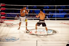 MMA fights without rules. Agoni Romero, Spain and Rinat Kul?tumanov, Russia Royalty Free Stock Images