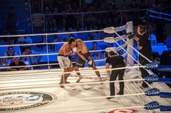 MMA fights without rules. Agoni Romero, Spain and Rinat Kultumanov, Russia. Royalty Free Stock Images