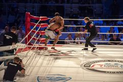 MMA fights without rules. Agoni Romero, Spain and Rinat Kultumanov, Russia. Royalty Free Stock Photos