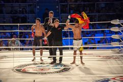 MMA fights without rules. Agoni Romero, Spain and Rinat Kultumanov, Russia. Royalty Free Stock Image
