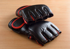 Mma gloves on wooden background Royalty Free Stock Images
