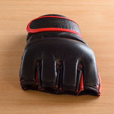 Mma gloves on wooden background Royalty Free Stock Photography