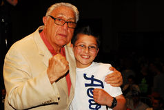 MMA Promoter Jimmy Burchfield, Sr. poses for a picture with a fan. Stock Images