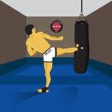 MMA spirit fighter and punching bag. Kicking man. Gym Royalty Free Stock Images