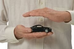 Mman with miniature car Stock Images