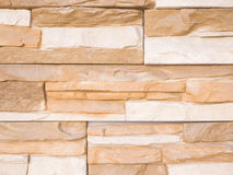 Mmasonry of stoun wall, background. A wall from an artificial gray stone facade with rough fractured surfaces Stock Photo