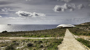 Mnajdra temples on malta. Mnajdra is a megalithic temple complex found on the southern coast of the Mediterranean island of Malta Stock Photo