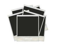 Många polaroidfoto som isoleras på en vit bakgrund Arkivfoton
