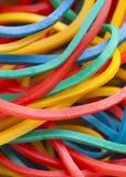 Mångfärgade elastiska musikband Arkivbild