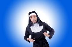 Männliche Nonne im lustigen religiösen Konzept Lizenzfreies Stockbild