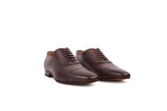 Männliche Schuhe auf dem weißen Hintergrund Stockfotografie