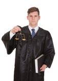 Männlicher Rechtsanwalt With Weight Scale und Buch Stockbilder