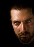 Männliches Gesicht mit furchtsamen Augen Stockfotografie