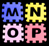 MNOP Alphabet learning blocks isolated Black Stock Image