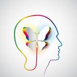 Mänskligt huvud med pappers- fjärilssymbolfrihet och kreativitet Arkivbilder