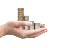 Münze in der Hand Stockfotografie