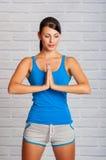 A moça é contratada na ioga Fotos de Stock
