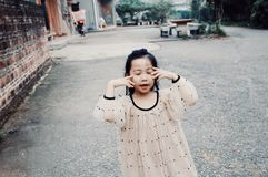 moça asiática com cara do sorriso imagem de stock