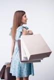 A moça atrativa está comprando tudo com Imagem de Stock Royalty Free
