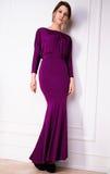 Moça bonita e feliz em um vestido de noite Imagem de Stock