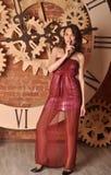 Moça bonita em um vestido vermelho Imagens de Stock Royalty Free