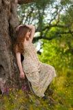 Moça bonita entre flores amarelas Fotos de Stock Royalty Free