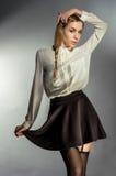 Moça bonita na saia preta fotografia de stock royalty free