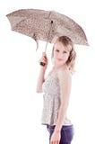 Moça bonita que está guardando o guarda-chuva Foto de Stock Royalty Free