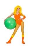 A moça com a bola suíça no branco Imagem de Stock Royalty Free