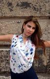 Moça com a camisa azul da saia e da flor Foto de Stock Royalty Free