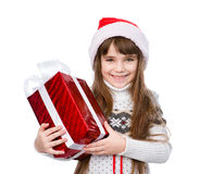 Moça com o chapéu vermelho de Santa que guarda a caixa de presente Isolado no branco Imagem de Stock Royalty Free